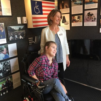 young woman in wheelchair and Alison Gilkey at the Disability Museum on Wheels exhibit