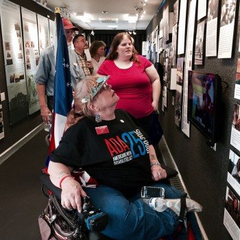 visitors at the Disability Museum on Wheels exhibit